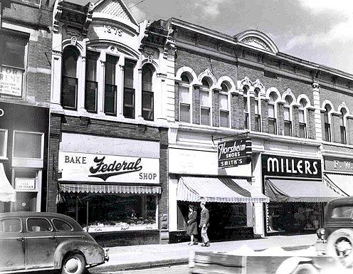 Federal Bakery, Smith Shoe Co., and Miller's Ready To Wear (located at 317, 319, 323 N. Main St.) Austin, Mn