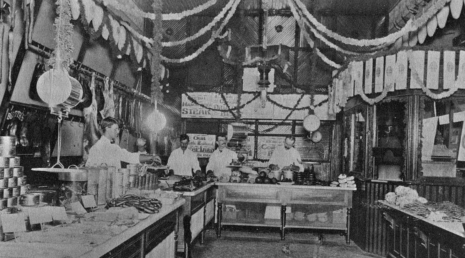 Hormel Provision Market in 1893. Herman Hormel was the manager, he is at the far right in the picture.