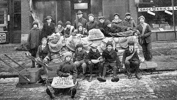 Williams Cigars and News with newspaper carriers in front of it - 1921