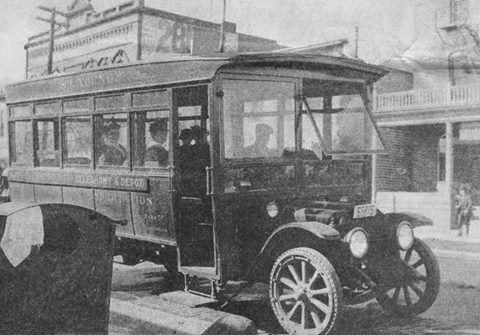 Austin's first bus picking up passengers on East Side - 1915 (looking towards the NW from the intersection of E. Water St. and N. Railway St. - 4th Ave. N.E. and 10th St. N.E.)