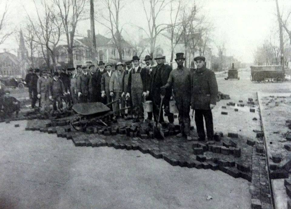 Laying creosote wooden blocks in 1913 on Maple Street (1st Ave. N.W.) - (removed in 1953 for new paving) Austin, Mn