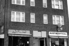 Apold Music and Austin Optical (located at 313 and 315 4th Ave. N.E.)
