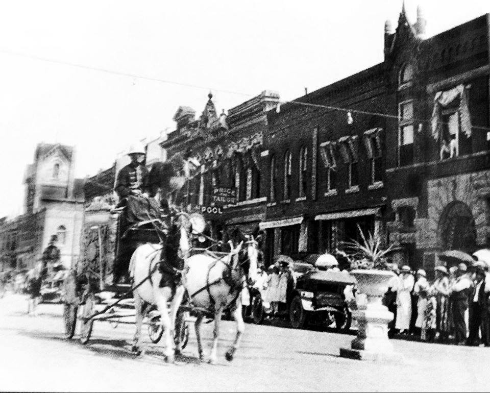 Circus coming to town...heading south on the 300 blk. of Main St. (unknown year) Austin, Mn