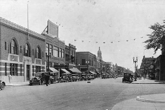 Main Street, looking south from where 1st Drive intersects. Lots of things you don't see anymore, like Model T's and the Shaw Gym for Boys Austin, Mn
