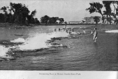 Swimming race at Austin's Downtown Mill Pond back in 1938-39. On the picture's right is where the city pool's parking lot is located today