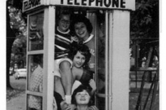 Austin High School students in a telephone booth - 1963